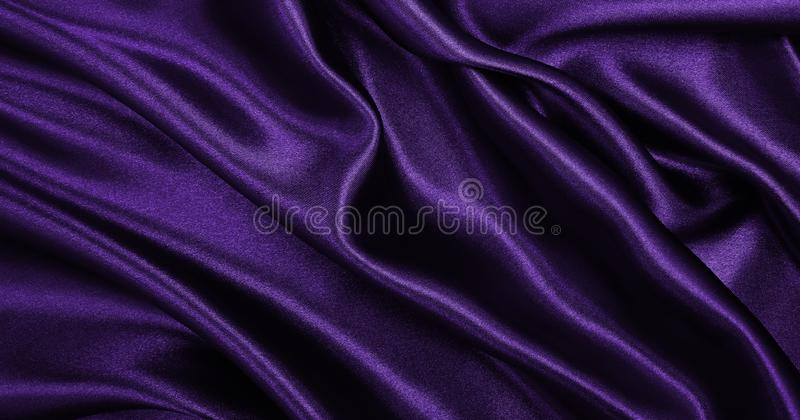 Smooth elegant lilac silk or satin luxury cloth texture as abstract background. Luxurious background design. Smooth elegant lilac silk or satin luxury cloth royalty free stock image