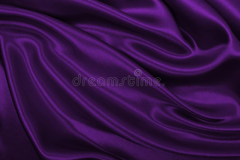 Smooth elegant lilac silk or satin luxury cloth texture as abstract background. Luxurious background design. Smooth elegant lilac silk or satin luxury cloth stock images