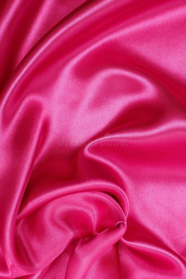 Smooth elegant pink silk or satin as wedding background stock photography