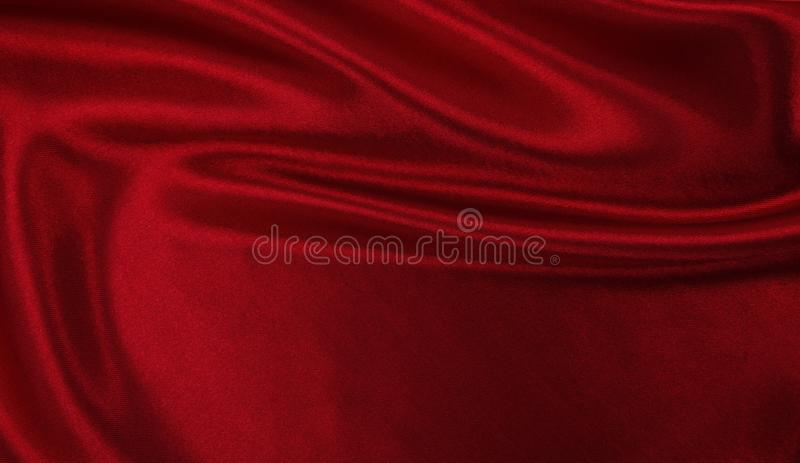 Smooth elegant red silk or satin luxury cloth texture as abstract background. Luxurious background design. Smooth elegant red silk or satin luxury cloth texture stock image