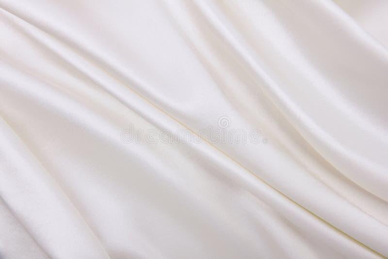 Smooth elegant white silk or satin luxury cloth texture as wedding background. Luxurious Christmas background or New Year. Smooth elegant white silk or satin stock images