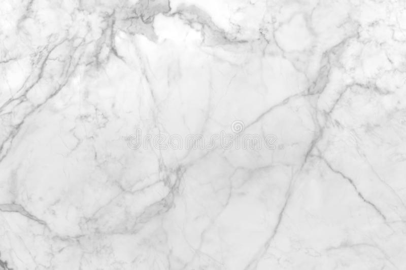 Smooth flat marble rock surface patterned  with white and streaks of gray royalty free stock photo