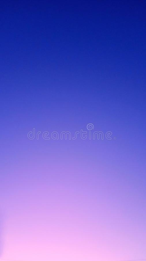 Smooth gradient from blue to pink through purple. Neon sky at sunset. horizontal abstract background wit royalty free stock photos
