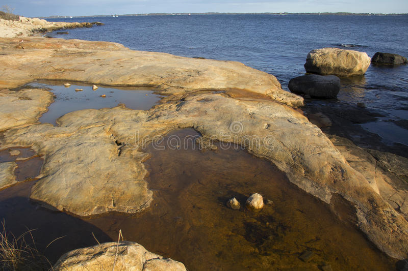 Smooth granite rocks along the shoreline of Connecticut. stock images