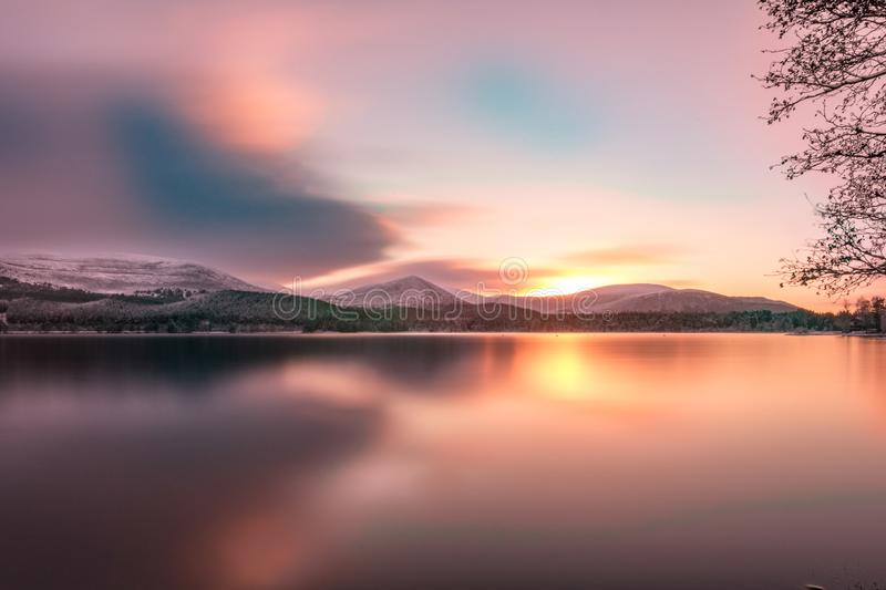 Smooth long exposure winter sunrise with orange yellow sun reflection and shadows stock photos