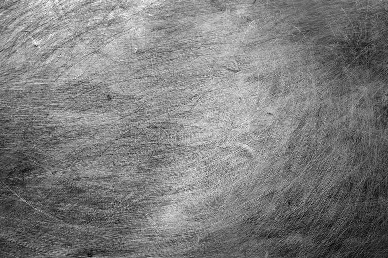 Smooth metal background texture with scratches stock image