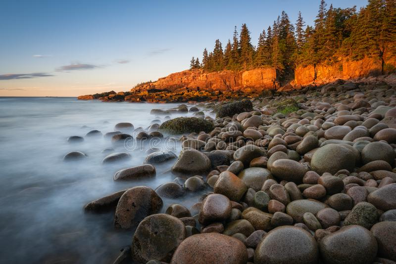 Long Exposure sunrise at Boulder Beach in Maine. Smooth ocean water in a cove along Acadia National Park coastline in Maine royalty free stock photo
