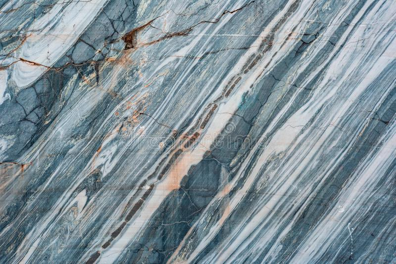 Smooth real marble texture  in the cracks. Smooth real marble texture in the cracks is close, pattern, wallpaper, surface, stone, textured, natural, detail, gray stock photography