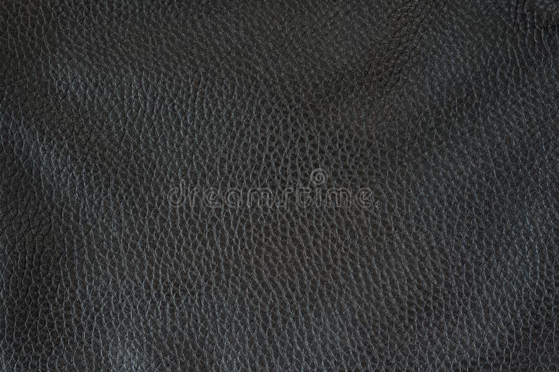 Smooth seamless texture Leather. Black color. Close up royalty free stock images
