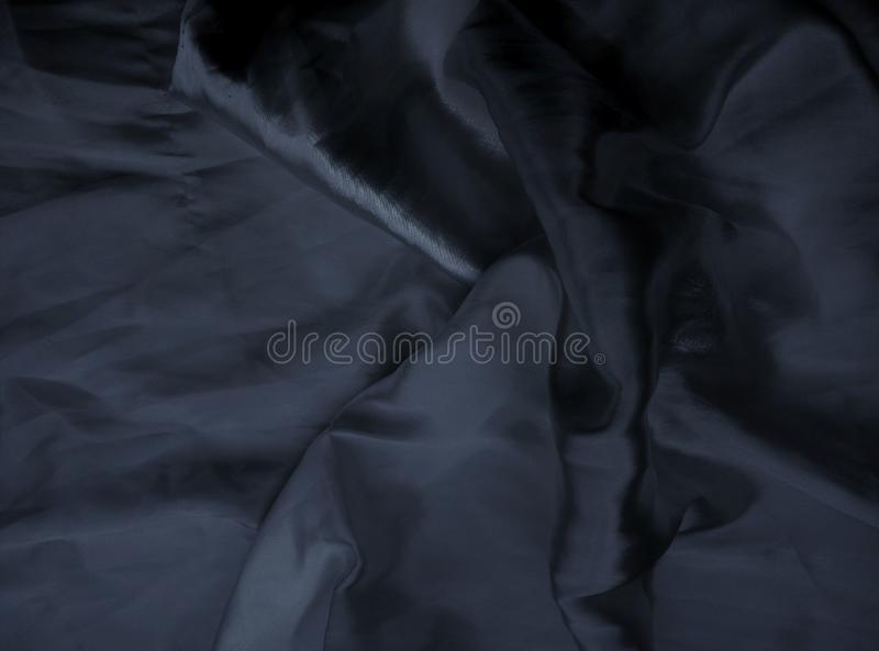 Smooth and sleek texture of black satin fabric stock photography