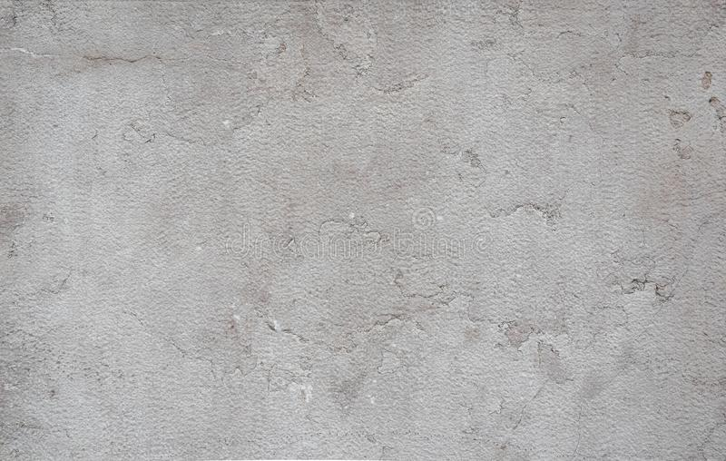 Smooth stone texture is gray-beige with cracks, spots. stock images
