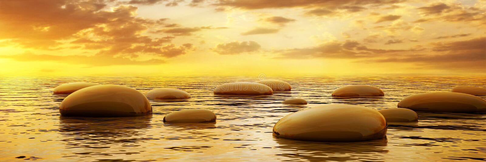 Smooth stones reflecting in water at sunset royalty free stock photos