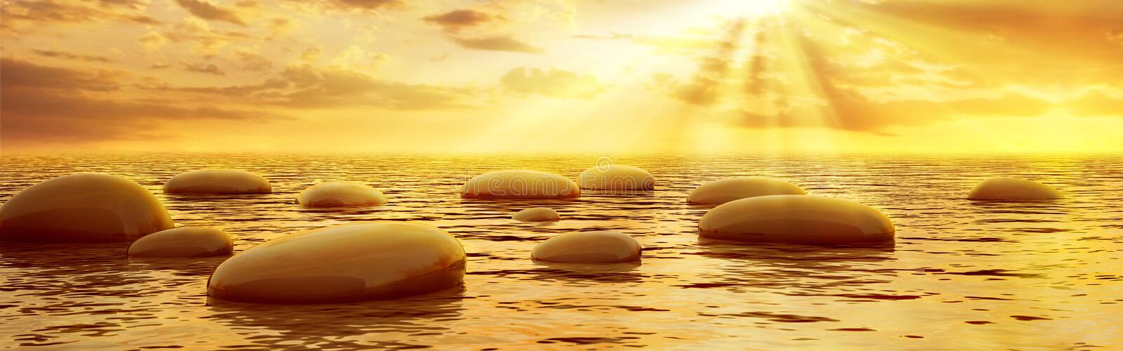 Smooth stones reflecting in water under sun beams stock photo