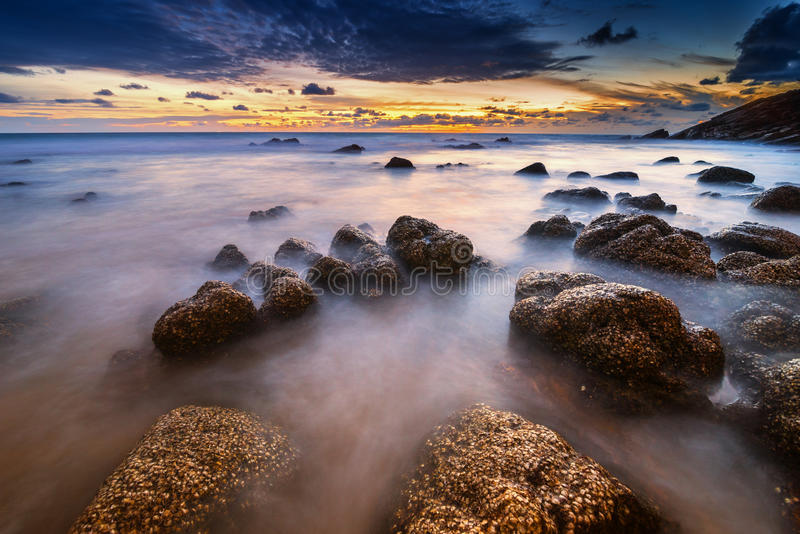 Smooth wave in evening. Warm smooth wave in sun set at Nai thorn Beach; Phuket ; Thailand stock photo