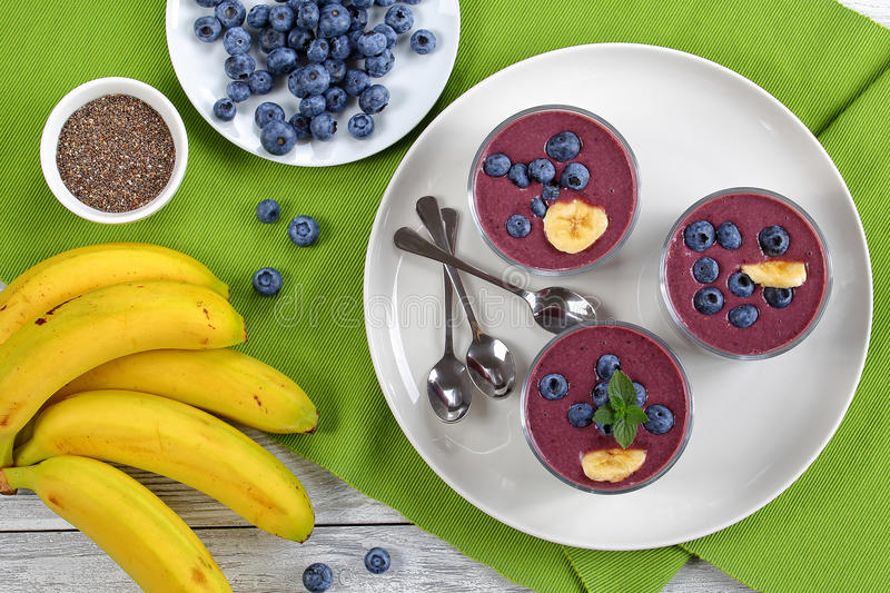 Smoothie with blueberries, chia and banana stock photos