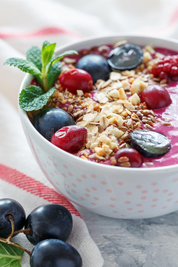 Red smoothie bowl with beets and black grapes. stock photos