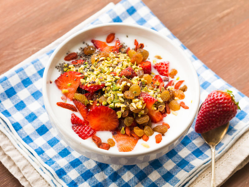 Download Smoothie Bowl With Strawberries, Dried Fruit And Chia Seeds Stock Photo - Image: 83721607