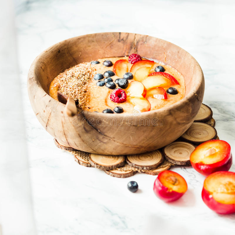 Free Smoothie Bowl With Peaches, Plums And Blueberries In A Wooden Di Royalty Free Stock Image - 75894236