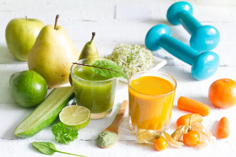Smoothie fresh fruits dumbell and young sprouts healthy life style food fitness concept. On white background stock image