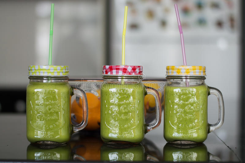 Smoothie in glasses with straws stock photos