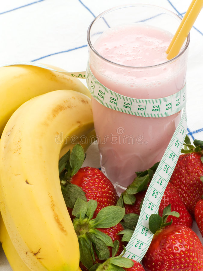 Smoothie made with strawberries and bananas. And a measure tape stock photo