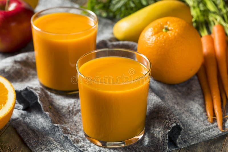 Smoothie orange organique sain Juice Drink de carotte images libres de droits