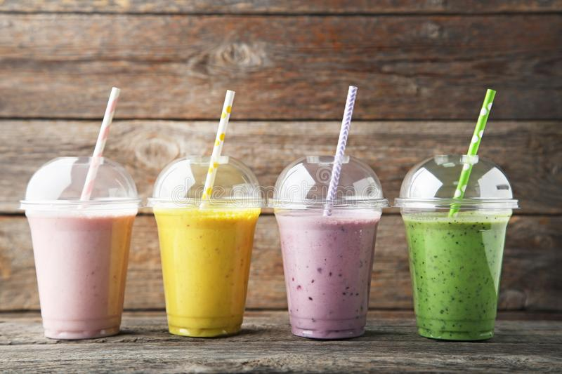 Smoothie in plastic cups stock photo