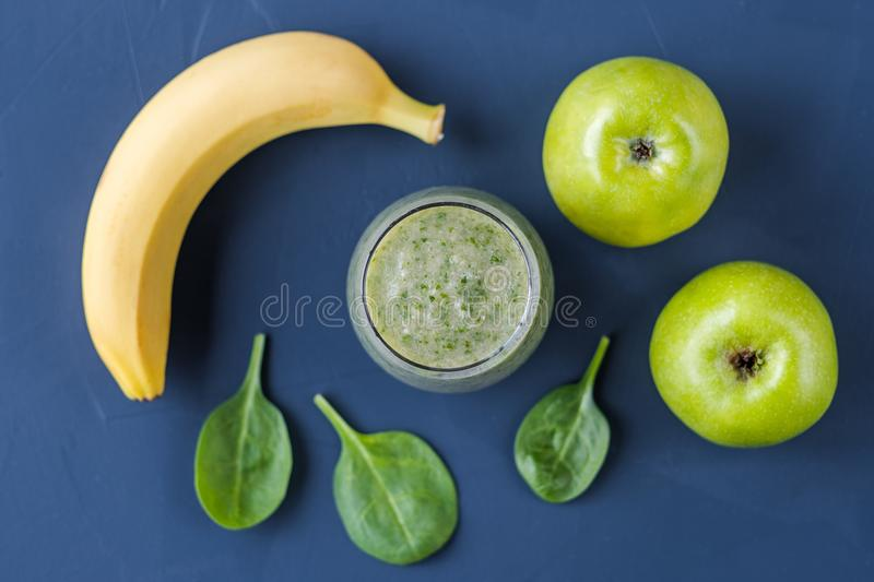 Smoothies of apple spinach banana. Healthy food. Smoothies of apple spinach banana royalty free stock photo