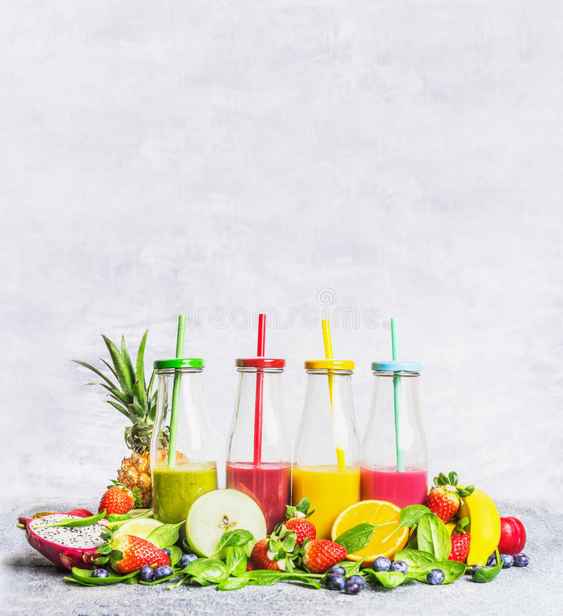 Smoothies assortment with fresh ingredients for mixing on light wooden background, side view. stock photo