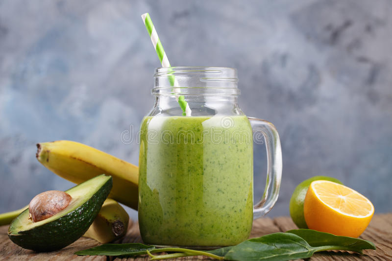 Smoothies of avocado, banana, citrus and spinach leaves royalty free stock images