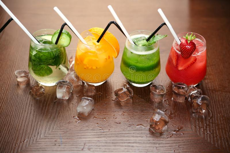 Smoothies cocktails on a wood backgroun. Smoothies cocktails on a dark wood background. ice royalty free stock photo