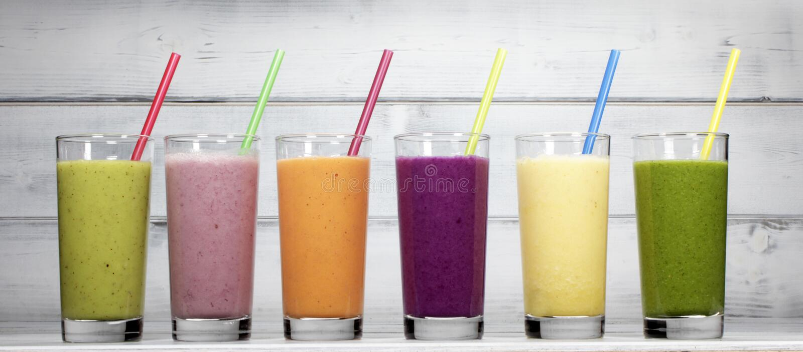 Smoothies. Different fresh fruit smoothies in glasses royalty free stock images