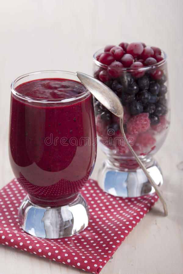 Smoothies of frozen raspberries, blueberries and cranberry with stock photography