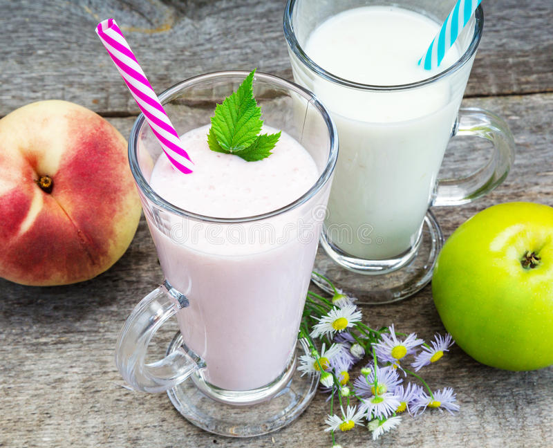 Smoothies, healthy eating. Smoothies, yogurt with fruit on old wooden surface, Healthy Eating stock photo
