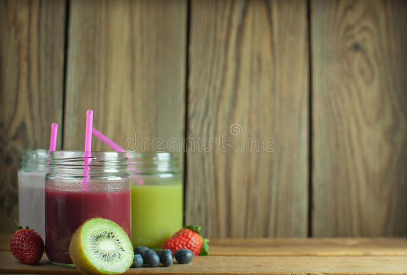 Smoothies in jars royalty free stock photography