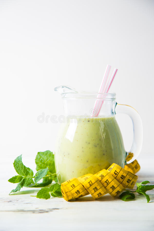 Smoothies and measuring tape. On table royalty free stock image