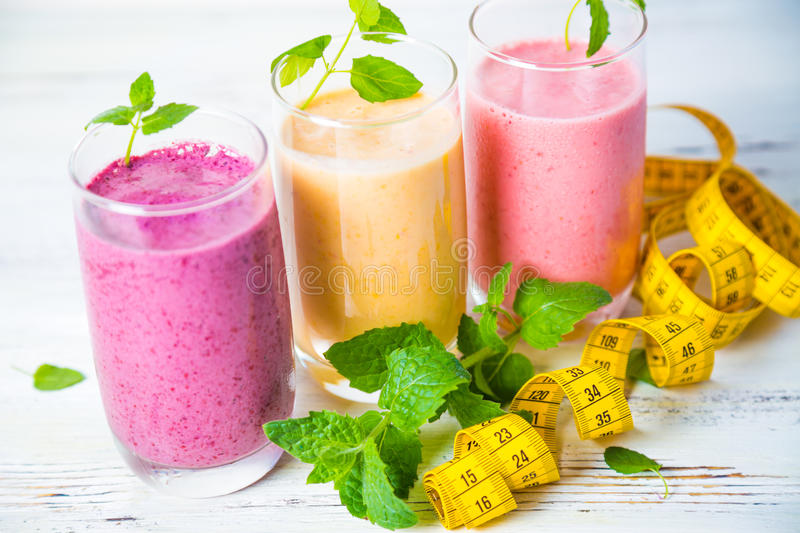 Smoothies and measuring tape. On table stock images