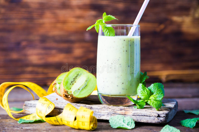 Smoothies and measuring tape. On table royalty free stock images