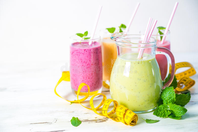 Smoothies and measuring tape. On table royalty free stock photo