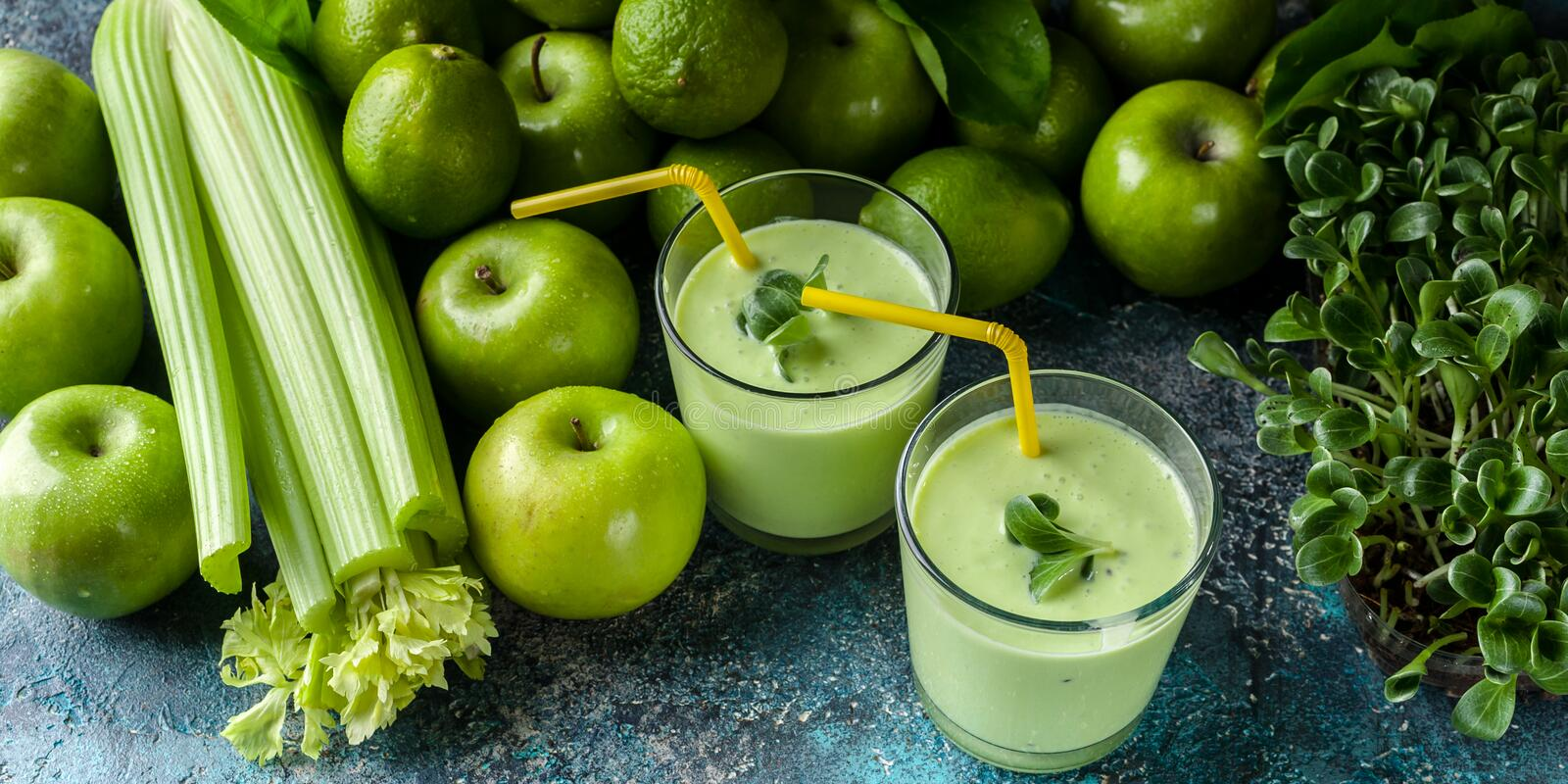 Smoothies: milk thistle green and green fruits on a concrete background. Food detox banner royalty free stock photos
