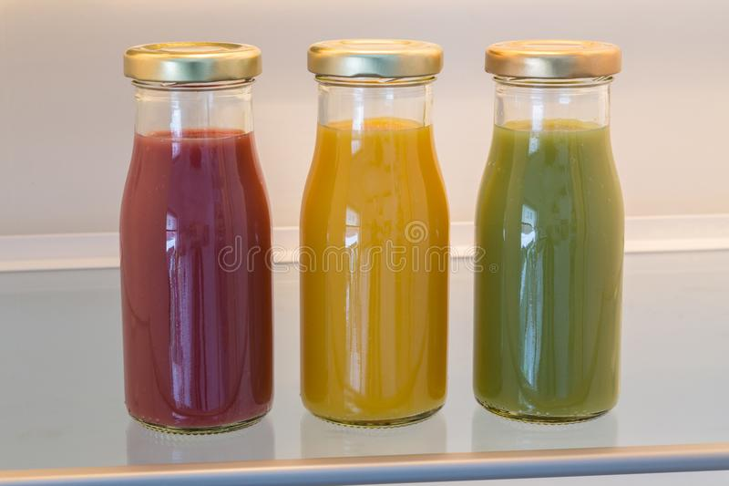 Smoothies in open refrigerator concept.  stock photo