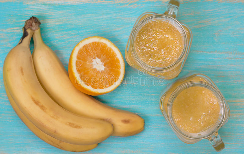 Smoothies with orange and banana (Top view, selective focus) stock images