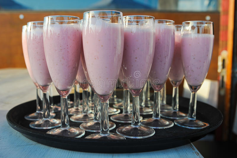Smoothies. Pink smoothies in a champagne glass stock photography