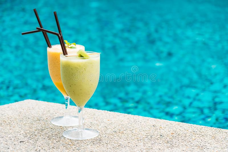 Smoothies with pool background. Iced fruit smoothies with pool background stock images