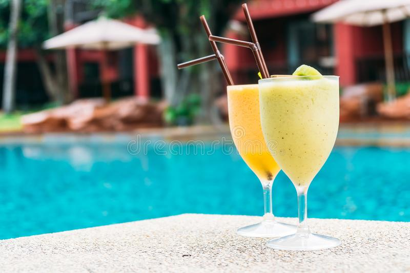 Smoothies with pool background. Iced fruit smoothies with pool background royalty free stock photo