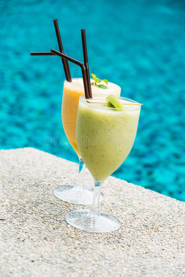 Smoothies with pool background. Iced fruit smoothies with pool background stock photos