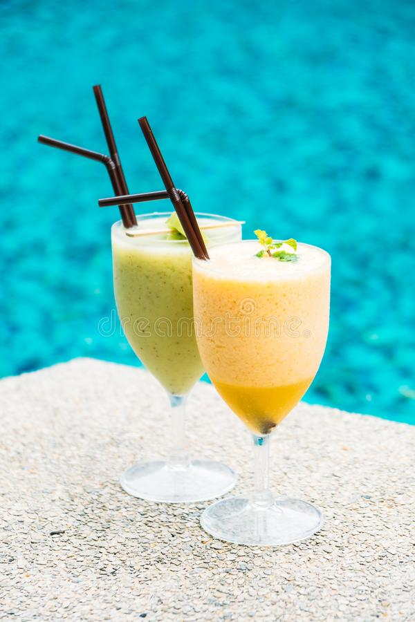 Smoothies with pool background. Iced fruit smoothies with pool background stock photography