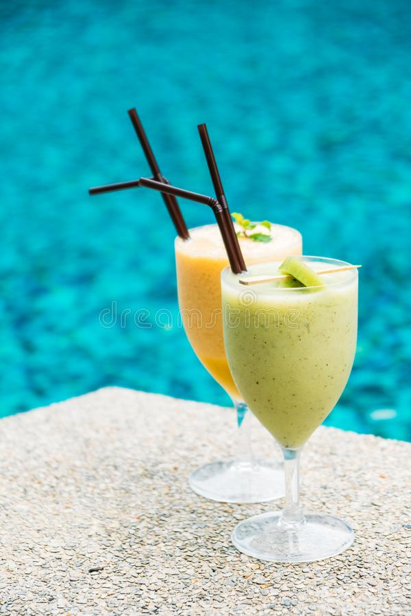Smoothies with pool background. Iced t smoothies with pool background stock images