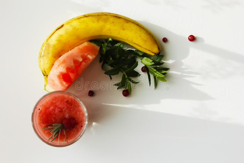 Smoothies useful vitamins diet of watermelon smoothie banana and cranberry royalty free stock photography