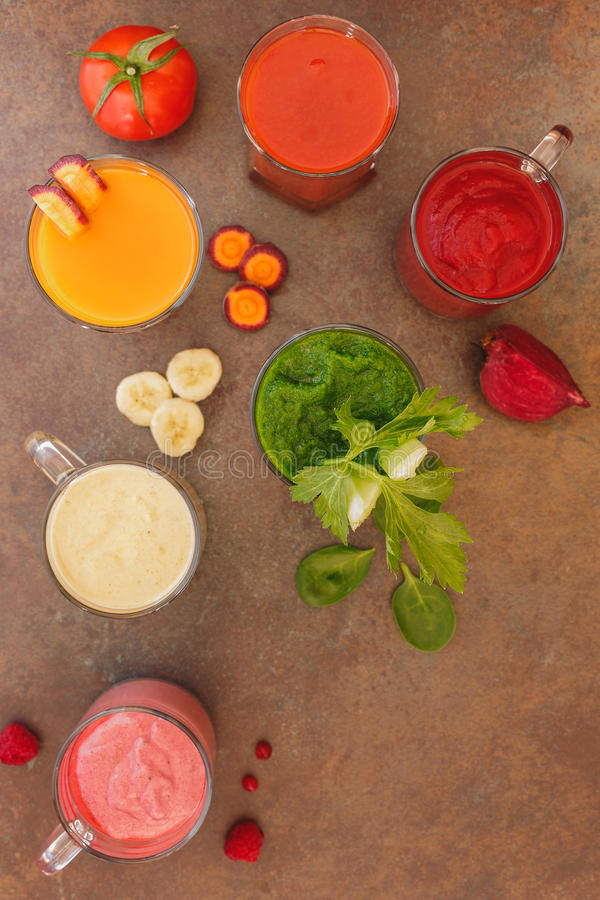 Smoothies with various ingredients. Colorful smoothies with various ingredients. Top view, blank space, rustic surface stock photos